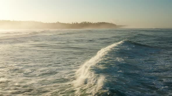 Thumbnail for Following large waves at sunrise