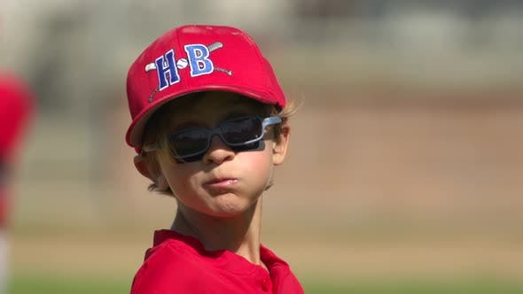 Kids playing little league baseball. - product preview 0