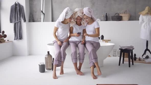 Thumbnail for Three Positive Girlfriends in the Same Pajamas and Towels on Heads Spending Time Together at Home
