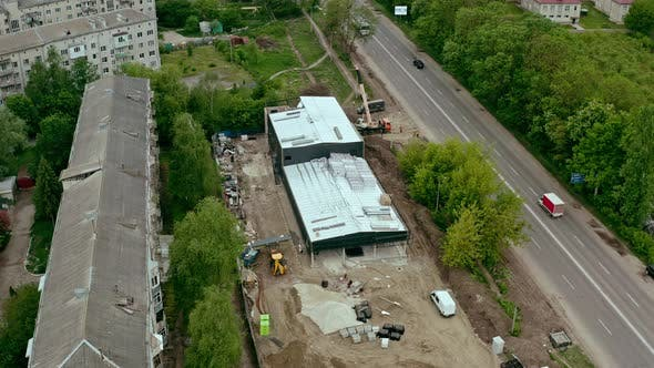 Thumbnail for Aerial Shot of the Building in the Process of Construction Warehouse, Retail Space . Labor Working