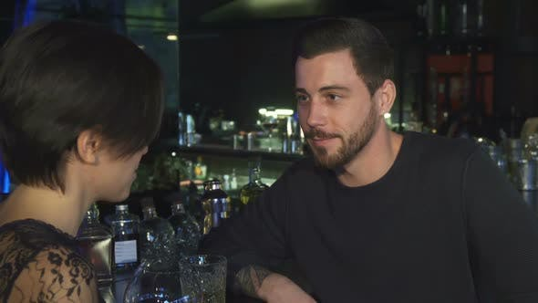 Thumbnail for Handsome Young Man Talking To His Beautiful Girlfriend at the Bar