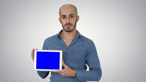Thumbnail for Arab Man Showing Blank Tablet Screen on Gradient Background