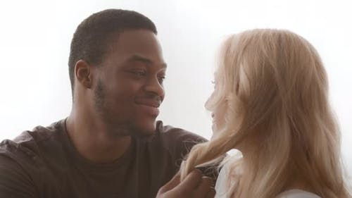 Loving African American Husband Touching Wife's Hair Talking Flirting Indoors