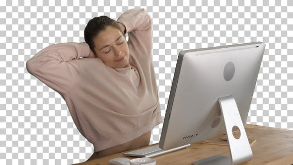 Thumbnail for Happy Relaxed Young Woman Sitting Stretching in Front of Computer