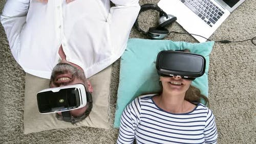 Couple in VR Headsets