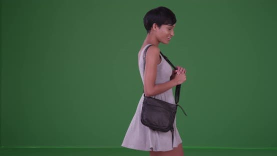 Thumbnail for Happy smiling woman spinning on green screen