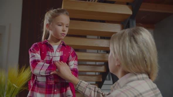 Thumbnail for Stubborn Schoolgirl Listening To Mom's Admonition