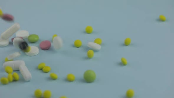 Thumbnail for Medical Pills Falling Down. Medicine Concept. Coloured Capsules, Pills, Tablets