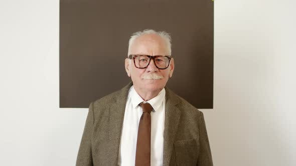 Thumbnail for Elderly Man in Suit and Glasses Smiling for Camera