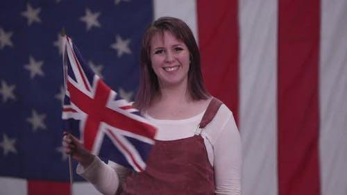 Woman waving the Union Jack Flag