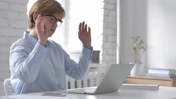 Cover Image for Loss, Frustrated Old Woman Working on Laptop