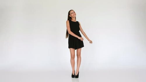 Pretty Happy Girl In Short Dress Dancing On White Background