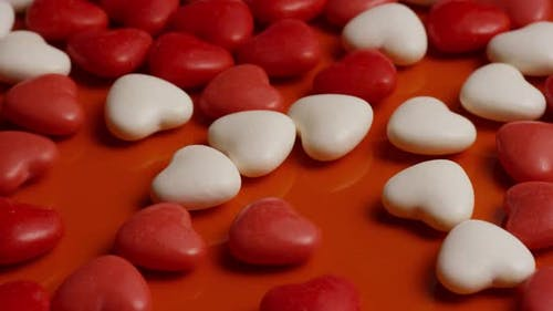 Rotating stock footage shot of Valentines decorations and candies - VALENTINES 0065