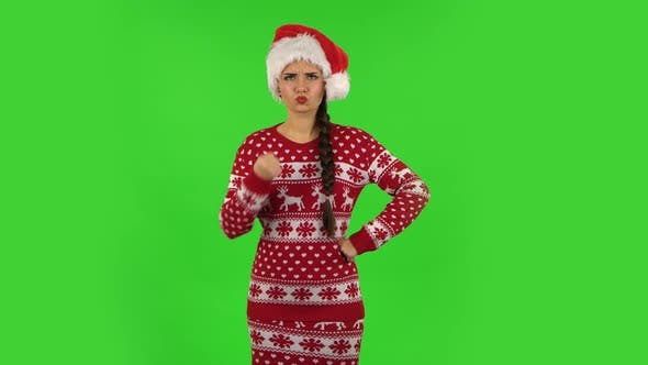 Thumbnail for Sweety Girl in Santa Claus Hat Threatens with a Fist. Green Screen