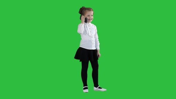 Thumbnail for Happy girl with mobile phone Isolated on a Green Screen