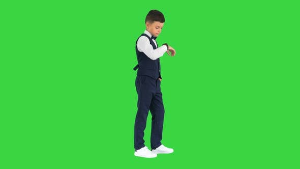 Thumbnail for Schoolboy in Waistcoat and Bow Tie Checking His Watch Rolling Eyes and Sighing on a Green Screen