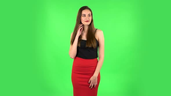 Thumbnail for Young Woman Stands Waiting on Green Screen