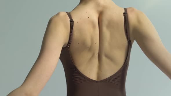 Fragile Graceful Back of a Young Ballerina Who Dances Classical Ballet. Dance Studio Lesson. Back