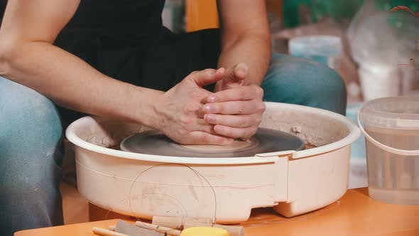 Thumbnail for Pottery - the Master with Wet Hands Is Begining To Pull the Clay Up