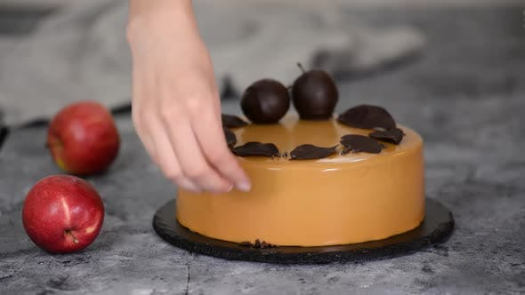 Thumbnail for Pastry Chef Decorating the Mousse Cake with Small Chocolate Pieces, Pastry Chef Decorated Modern