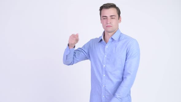 Thumbnail for Young Happy Handsome Businessman Snapping Fingers and Showing Something