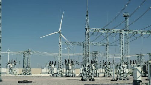 Windturbine Generates Electricity By High Voltage Substation