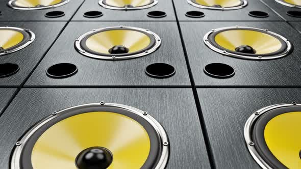 Thumbnail for Moving Diagonal Over Audio Speakers with Yellow Membranes Playing Modern Music