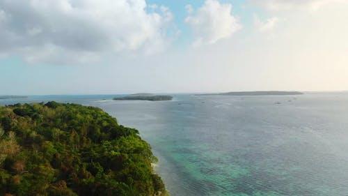 Aerial: uncontaminated coastline tropical beach caribbean sea at Pasir Panjang K