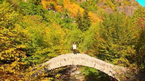 Female Tourist Walks On Ottomon Style Bridge Landmark