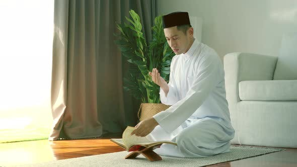 Thumbnail for Asian Muslim Man Praying at Home