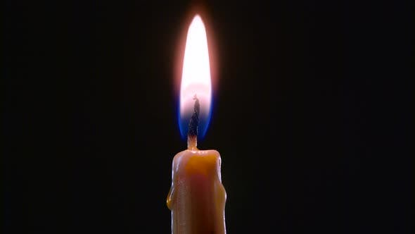 Thumbnail for Hand with a Cigarette Lighter Ignites One Candle. Black Background. Close Up