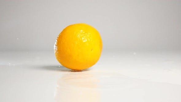 Thumbnail for Orange Half Dropping Down