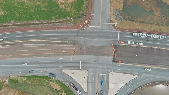 Major asphalt road intersection with multiple highways lanes,
