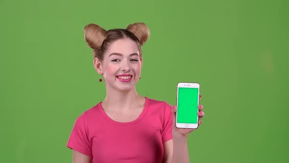 Thumbnail for Girl Advertises the Phone. Green Screen
