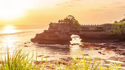 Sunset at Batu Bolong and Tanah Lot Temple in Bali, Indonesia. Timelapse