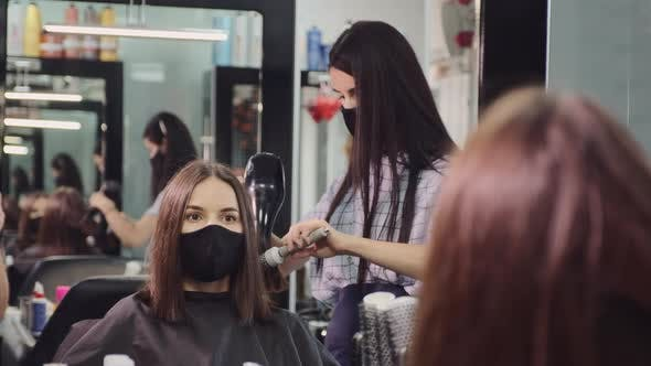 Thumbnail for Woman in Protective Mask Works with Client Hair in Salon