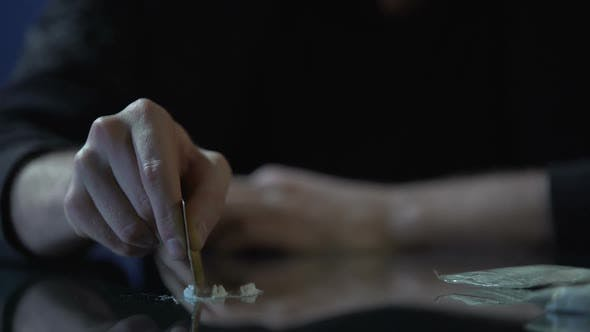 Thumbnail for Close-Up of Male Hand Making Lines of Cocaine Dose, Drug Addiction Problem