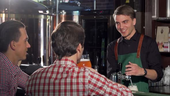Thumbnail for Handsome Bartender Working, Serving Delicious Beer To His Client