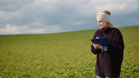 Cover Image for Female Farmer Examining Oilseed Rape Field