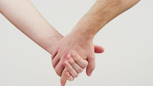 Thumbnail for People holding hands