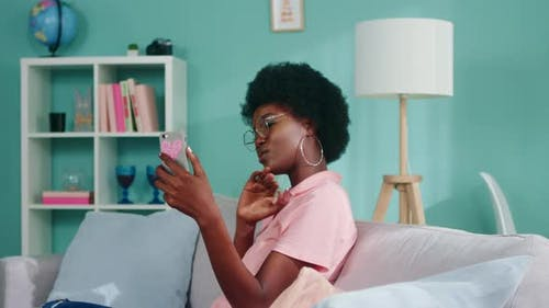 Young Woman Enjoys Video Call with Friend