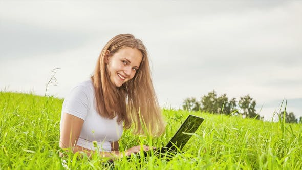 Thumbnail for Women With Laptop on Green Meadow