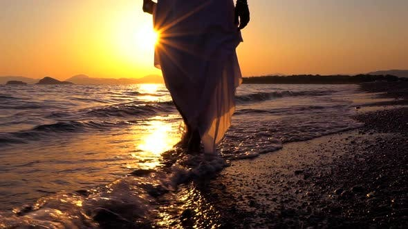 Cover Image for Feet Walking At Seashore Sunset