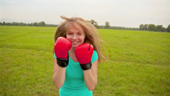 Thumbnail for Girl in Boxing Gloves in a Meadow