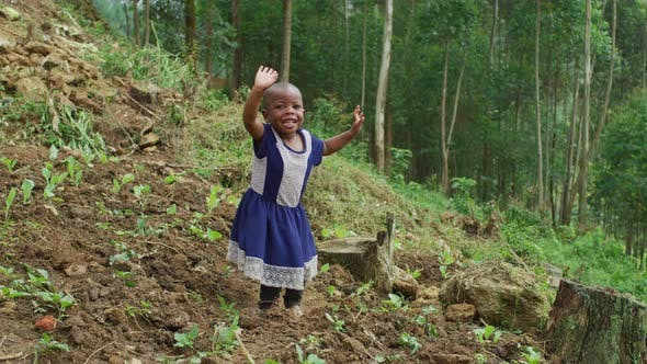 Thumbnail for African girl jumping and waving her hands