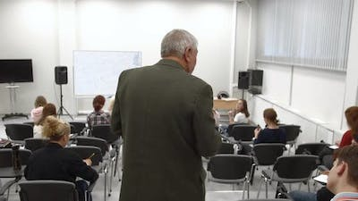 Professor Walks in the Classroom and Gives a Lecture
