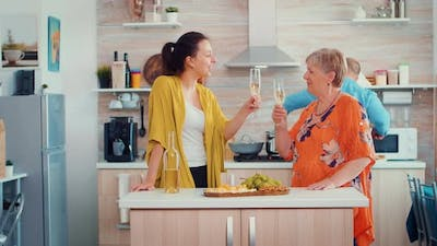 Mother and Daughter Clinking Glasses of Wine