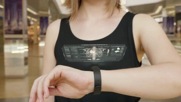 Young Girl Press on Futuristic User Interface Concept Bracelet. Graphical User Interface - GUI. Head