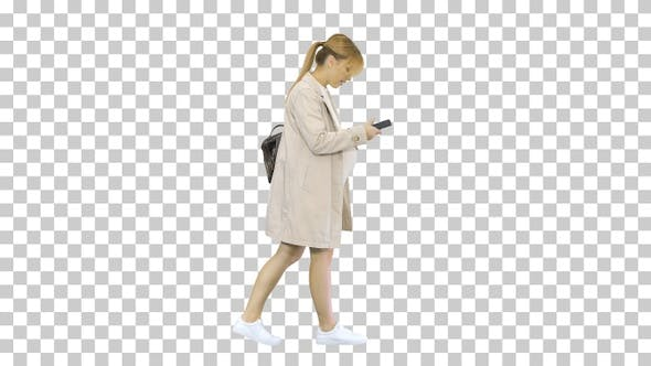 Thumbnail for Pregnant girl with phone in hand walking, Alpha Channel