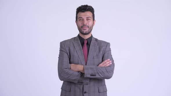 Thumbnail for Happy Bearded Persian Businessman Smiling with Arms Crossed